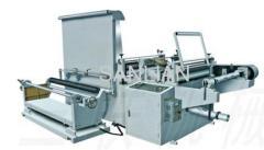 Sanitary napkin making machines