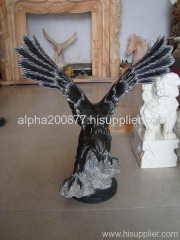 stone carved eagle statue