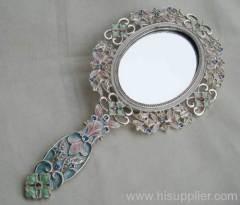 silver hand mirror