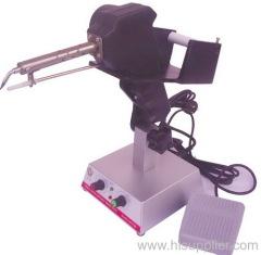 Foot soldering machine