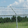 Barbed chain link fence