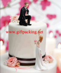 Bride Reaching And Helpful Groom Cake Topper