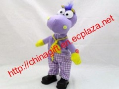 Electric powered singing and dancing plush dinosaur