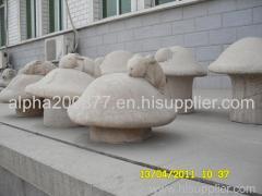 stock marble rabbit statue on rock