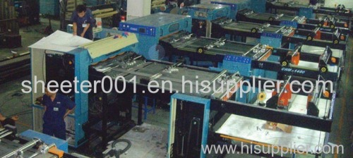 Paper and paperboard sheeting machine