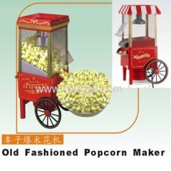 Old fashioned hot air popcorn maker with cart
