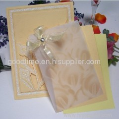Handmade paper wedding cards with shinning gold powder
