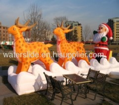 Reindeer with inflatable Christmas Santa Claus