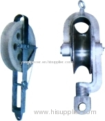 Hold -down pulley block
