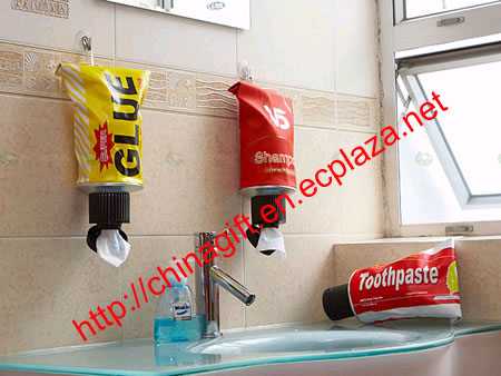 Collapsible tube tissue dispensers