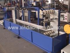Strap band making machine