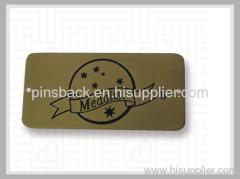 die- struck name tag
