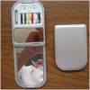 Compact mirror with sewing kit
