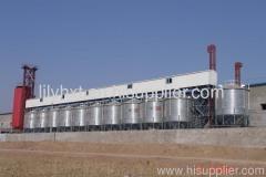 Grain steel silo with elevator