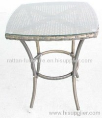 wicker dining chair with tea table