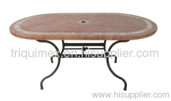 Wrought iron and ceramic mosaic oval dining table with parasol base