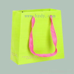 Printed paper bag with woven tape handle