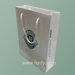 white cotton rope paper bag