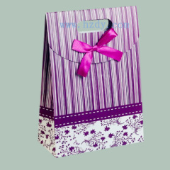 Adhesive paper bag for gift