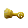 yellow smile face plastic brush