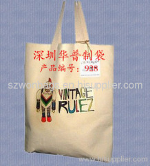 Foldable cotton bag with integrated pocket