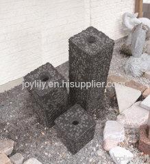 Three column stone fountain