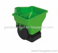Plastic hand held seed fertilizer spreader