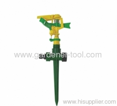 garden lawn sprinkler with plastic spike and connector.