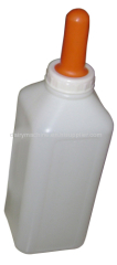 calf feeding milk bottle