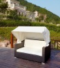 Garden chaise lounge with footrest and roof