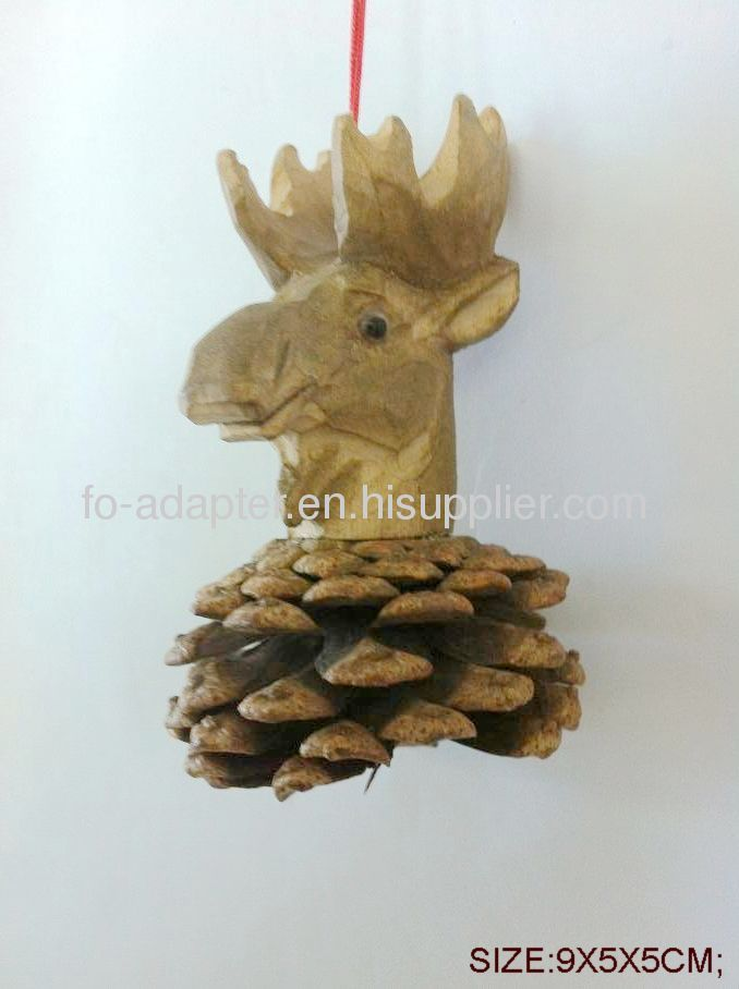 Hand carved wooden animalhead on pine cone
