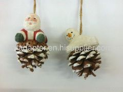 santa clause wood carving haing pinecone