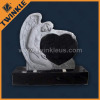 American style stone momument with angel statue