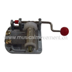 MINIATURE 18 NOTE PATTERN HAND CRANK MUSIC BOX