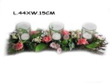 wooden spring with glass candle holder