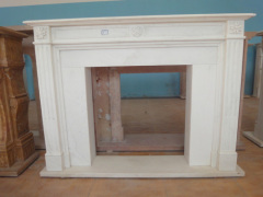 simple white marble fireplace mantel