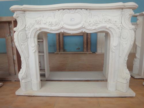 carved flowery fireplace frame