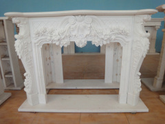 flowery carved marble mantelpiece