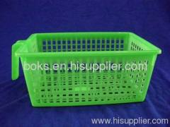 green plastic soft storage basket