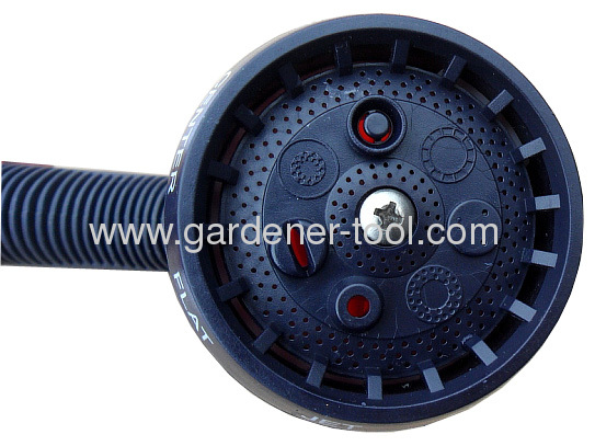 Plastic 7-pattern spray nozzle as garden water equipment to irrigate plant.