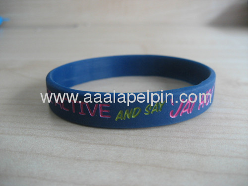 Charmed Royal blue Silicone Wristband Embossed In two colors LOGO