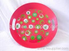 small red plastic Christmas plates