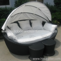 Outdoor rattan chaise lounge with footrests
