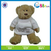 teddy bear stuffed toy in white sweater