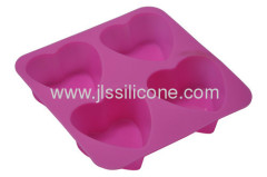 Silicone muffin or jelly or chocolate baking pan in pink heart shape