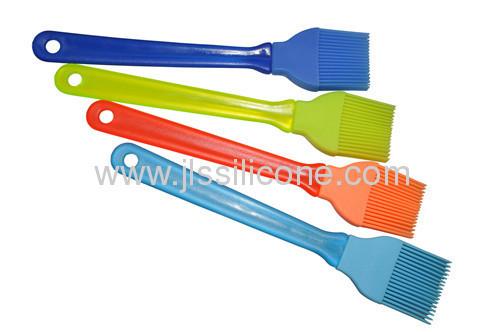 Plastic handled silicone grip brush