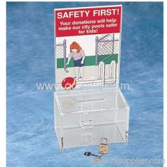 The clear acrylic ballot box with sign holder
