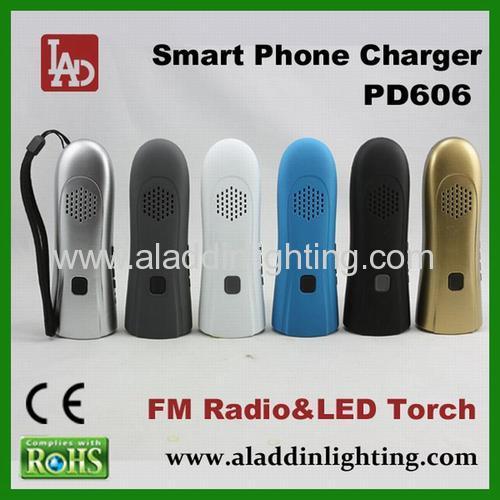 Crank dynamo powered FM radio torch for smart phone