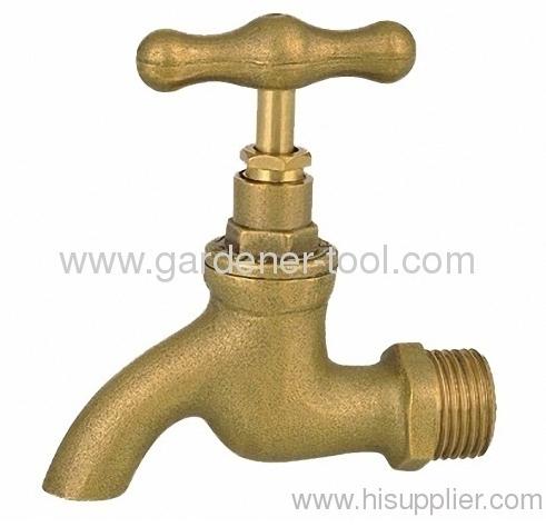 Brass outdoor water bibcock as water source in the garden