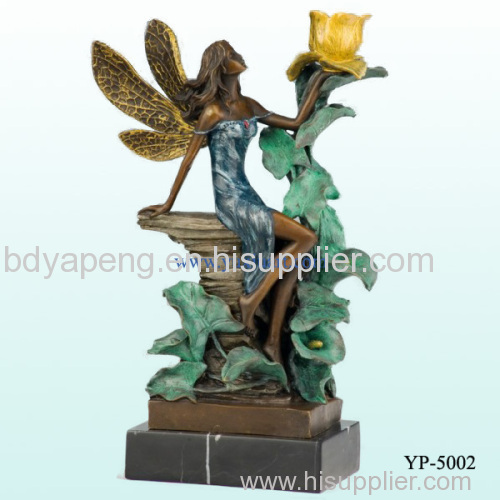 bronze candle holder statue